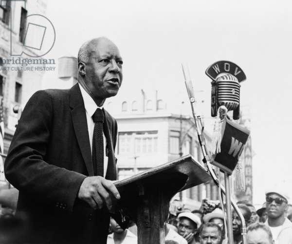 A. Philip Randolph making speech at rally supporting Harlem Congressman Adam Clayton Powell. Aug. 1958