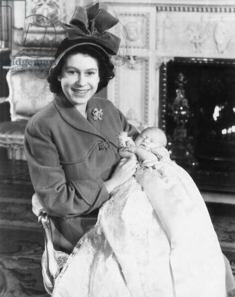 British Royal Family. Princess (and future Queen) Elizabeth of England and future Prince of Wales Prince Charles, after his christening, Buckingham Palace, London, England, 1948
