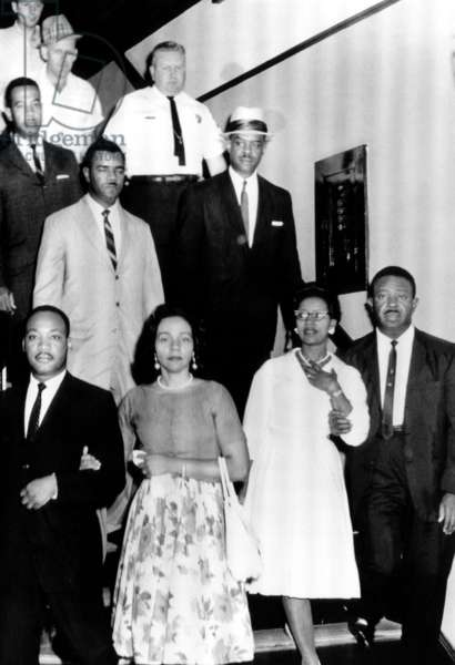 front row: Reverend Martin Luther King Jr., Coretta Scott King, Juanita Abernathy, Reverend Ralph Abernathy. The Reverends are shown with their wives and lawyers on their way to jail, Albany, Georgia, July 10, 1962.