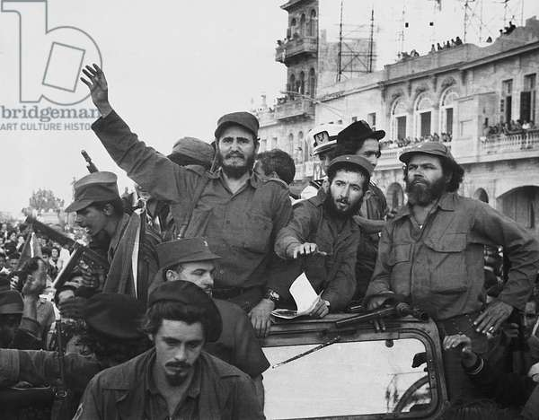 Fidel Castro, with his fellow revolutionaries, entering Havana on January 8, 1959. They are surrounded by crowds of people after their overthrow of Fulgencio Batista's dictatorship.