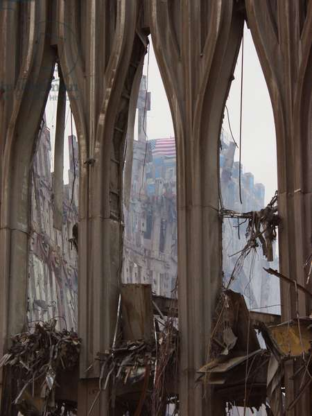 Fragment of the façade of WTC 1, the South Tower façade on Sept. 21, 2001. Through the center arch a flag can be seen on the damaged New York Telephone (now Verizon) Building. World Trade Center, New York City, after September 11, 2001 terrorist attacks