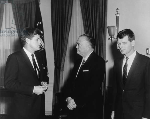 President Kennedy, J. Edgar Hoover, and Robert Kennedy in the White House Oval Office. Feb. 23, 1961