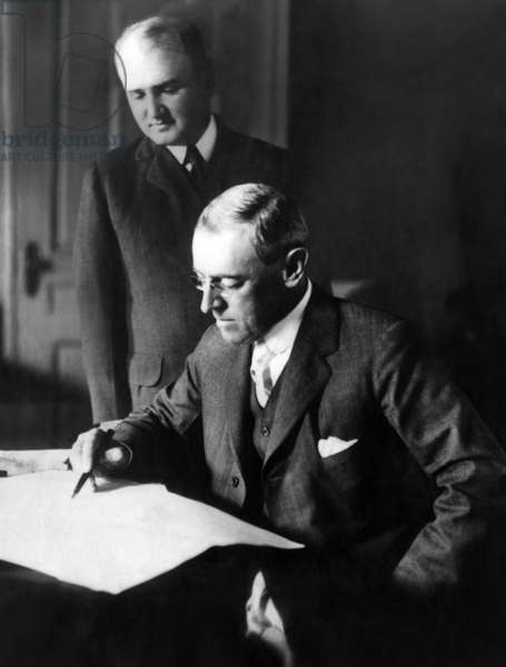 President Woodrow Wilson (front), with his secretary Joseph Tumulty, c.1919