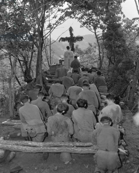 Chaplain conducts services north of Hwachon, Korea, for men of 31st Regiment. August 28, 1951. Korean War, 1950-53