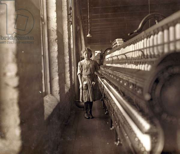 Cotton Mill. An underage girl tends a cotton spinner . Daniel Mfg. Co., Lincolnton, North Carolina. Photo by Lewis Hine Wickes, Nov 1908