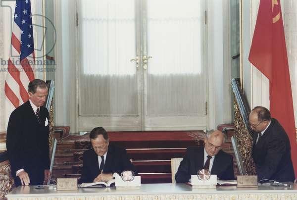 President George Bush and Soviet President Mikhail Gorbachev sign the Strategic Arms Reduction Treaty START Moscow Soviet Union. July 31 1991