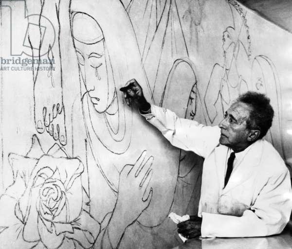 Jean Cocteau works on a mural in the Lady Chapel of the French Church of Notre Dame in London, 1959