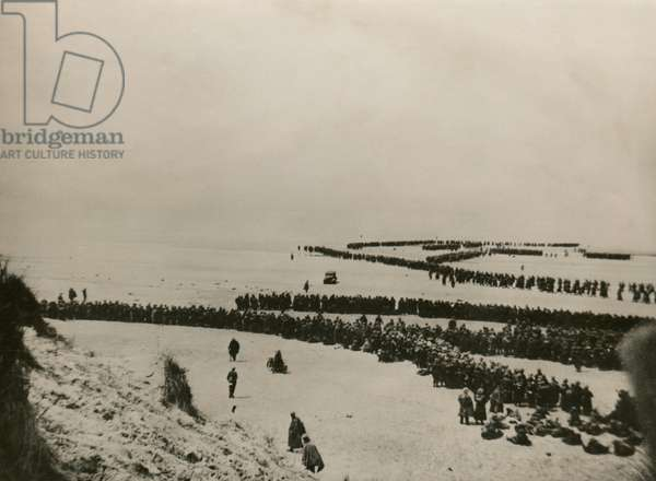 Military evacuation of Dunkirk during World War 2. Thousands of British and French troops wait on the dunes of Dunkirk beach for transport to England. May 26-June 4, 1940