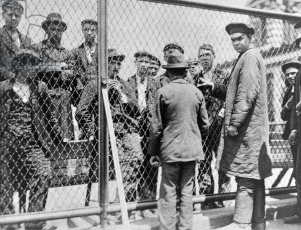 Immigration. Failed immigrants awaiting deportation on the roof of the main building at Ellis Island. Halftone photograph c. 1902