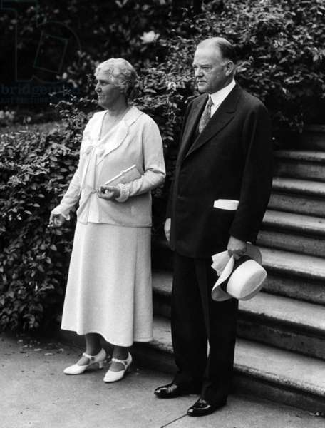 President Herbert Hoover and first lady, Lou Henry Hoover, pose for the annual presidential year photo in the garden of the White House, June 15, 1932.