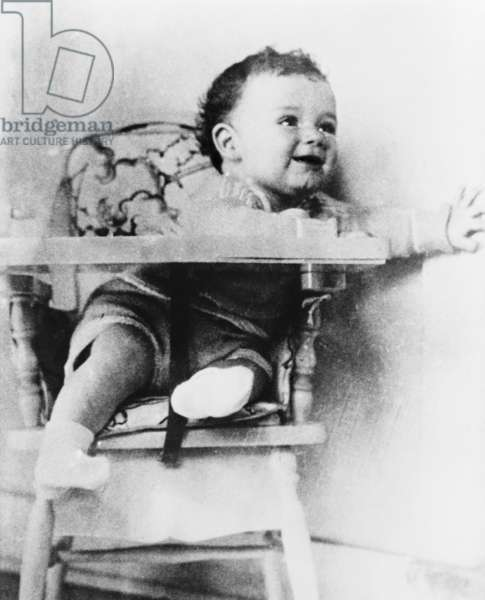 Charles A. Lindbergh Jr., son of the celebrated aviator, in highchair