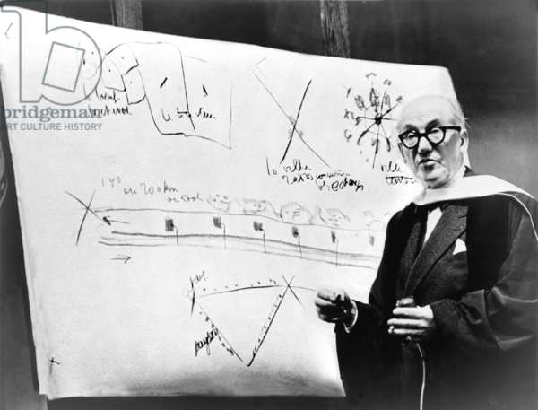 Le Corbusier (1887-1965), during a 1961 lecture, using design sketches. Le Corbusier was among the first generation architects who discarded the classical Greco-Roman vocabulary