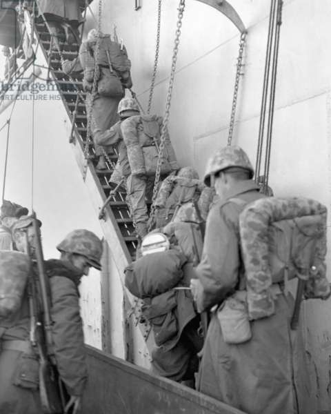 U.S. Marines board a ship for evacuation from Hungnam, North Korea, after their withdrawal from the Chosin Reservoir on Dec. 12, 1950. The UN invasion into North Korea was repulsed by the Chinese Volunteer Army in Nov.-Dec. 1950. Korean War, 1950-53