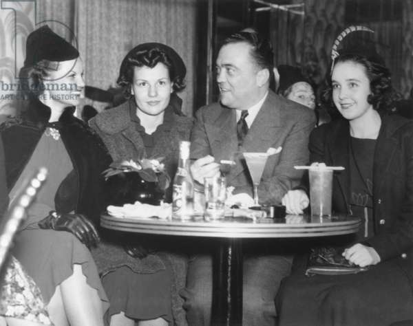 FBI Director J. Edgar Hoover at the Stork Club with three young women. At right is 1930's supermodel, Marion Morehouse. c. 1934-1940