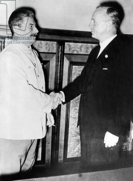 Soviet General Secretary Josef Stalin (left), shaking hands with German Foreign Minister Joachim von Ribbentrop as they conclude the German-Soviet non-aggression pact (aka the Molotov-Ribbentrop Pact), Moscow, Russia, 1939.