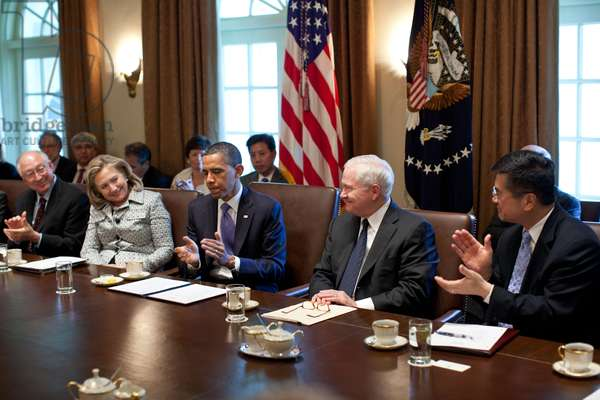 Defense Secretary Robert Gates receives cabinet applause after assassination of Osama Bin Laden. May 3, 2011. In center are Hillary Clinton, Barack Obama, and Gates