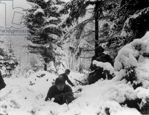U.S. infantrymen of the 290th Regiment fight in fresh snowfall near Amonines, Belgium. January 4, 1945, Battle of the Bulge, World War 2
