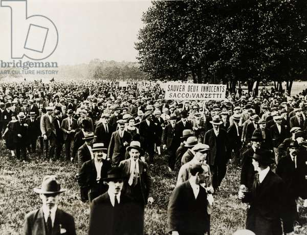 Paris sympathizers of Sacco and Vanzetti demonstrate. An immense demonstration was held in the Bois de Vincennes outside Paris by sympathizers of the two condemned Massachusetts radicals, Sacco and Vanzetti. c. Aug. 21, 1927. A sign reads, 'Saveur Deux Innocents, Sacco & Vanzetti'.