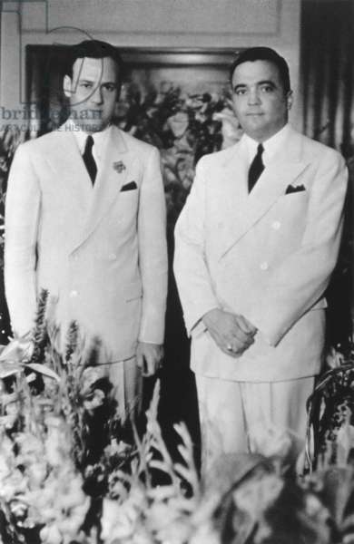 FBI Director J. Edgar Hoover's 20th Anniversary with Associate Director Clyde Tolson. After graduating from George Washington University Law School he was hired by the FBI in 1927. In 1930 Tolson was promoted to Associate Director. c. 1947 or 50