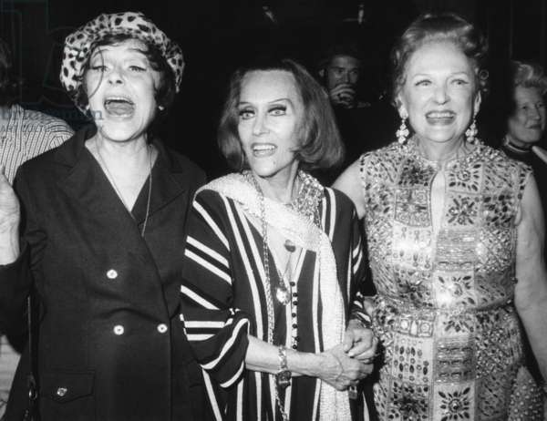 Gloria Swanson (center) with actress Fifi d'Orsay (left) and silent screen actress Carmel Myers. Swanson was giving a Schubert Alley party following her opening in the Broadway play 'Butterflies Are Free' on Sept. 14, 1972