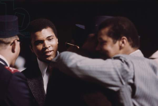 Muhammad Ali talks with fellow Black Muslims in Chicago March 1974
