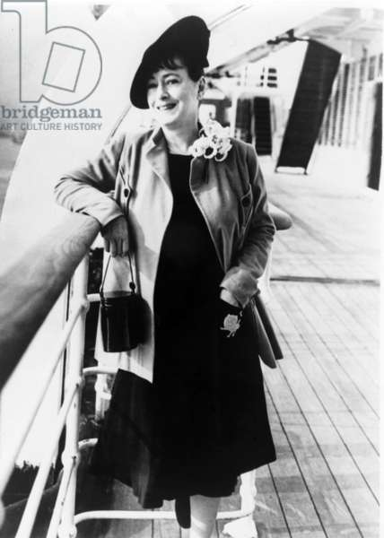 Dorothy Parker (1893-1967), American writer, poetess and member of the Algonquin Round Table, on board an ocean liner in 1939