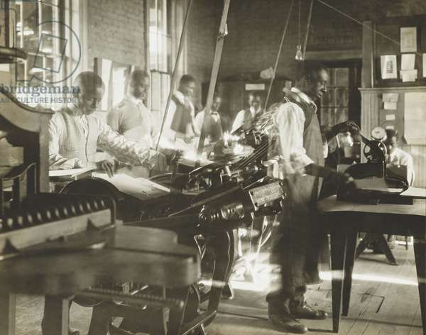 African American men working at printing presses. Photo by Arthur P. Bedou of New Orleans from National Urban League records. c. 1910-1925