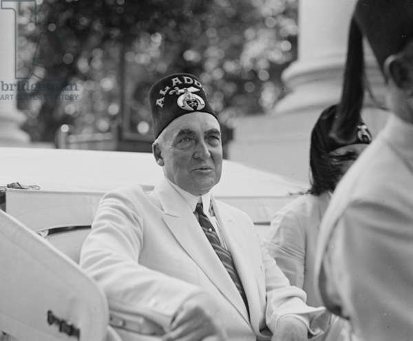 President Warren Harding (1865-1923) wearing ceremonial hat of fraternal organization. Harding was a Freemason, a fraternity dedicated to the Brotherhood of Man under the Fatherhood of a Supreme Being
