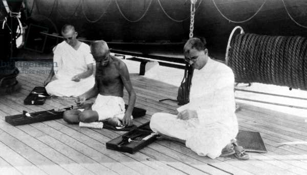 Mahatma Gandhi weaves cloth aboard the liner Rajputana while en route to London, England to attend the India Round Table Conference, 1931