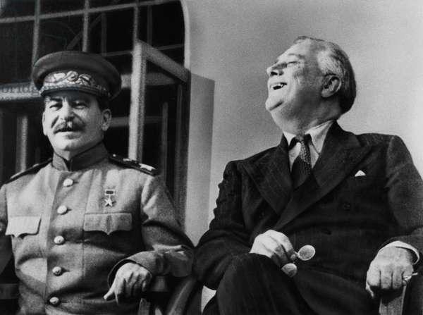 World War II. Soviet Premier Josef Stalin and US President Franklin Delano Roosevelt on the porch of the Russian embassy at Tehran, Iran, 1943