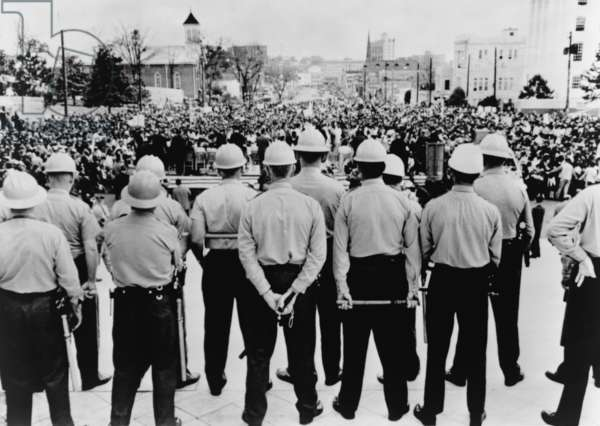 Selma to Montgomery March completed. Helmeted state conservation department agents with clubs stand on Alabama Capitol steps as 30,000 protester complete their march for Voting Rights. March 25, 1965