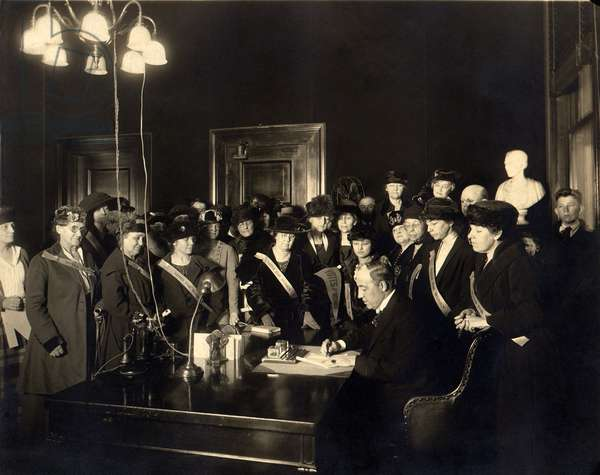 A room full women wearing Votes for Women' banners, witness Governor Edwin P. Morrow signing Kentucky's ratification of the 19th Amendment. Kentucky was the 24th state of the required 36 to ratify. January 6, 1920