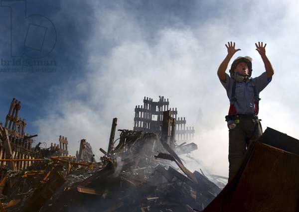 NYC Fireman signals for 10 more rescue workers to come into the rubble of the Ground Zero. Sept. 15, 2001. World Trade Center, New York City, after September 11, 2001 terrorist attacks. U.S. Navy Photo by Journalist 1st Class Preston Keres