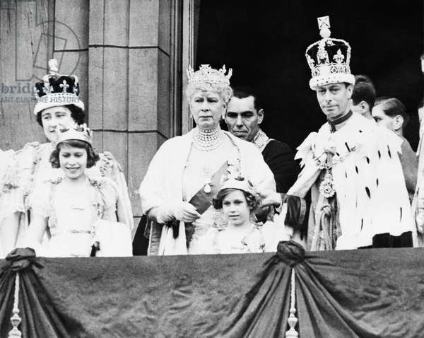 British Royal Family. From left: British Queen Elizabeth (future Queen Mother), Future British Queen Princess Elizabeth, British Queen Mary of Teck, Future Countess of Snowdon Princess Margaret, British King George VI, after the King and Queen's coronation, Buckingham Palace, London, England, May 12, 1937