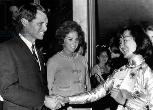 Robert Kennedy and Ethel Kennedy greet Nguyen T. Phuong Dung of South Vietnam during a reception for foreign students, Washington D.C., February 25, 1965.