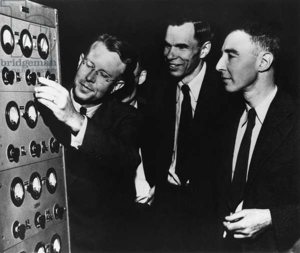 Ernest Lawrence, Glenn Seaborg, and Robert Oppenheimer at the Radiation Laboratory. All three scientists were working at the University of California, Berkeley. Early 1946.