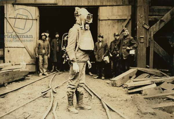 Man equipped with Draeger Oxygen Helmet, about to enter a coal mine in Pennsylvania. January 1911 photo by Lewis Hine