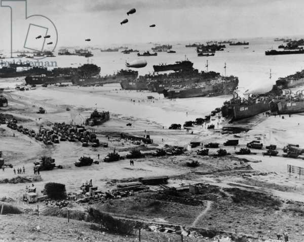 Omaha Beach after D-Day. Protected by barrage balloons, ships delivered trucks loaded with supplies. June 7-10, 1944, World War 2. Normandy, France, World War 2