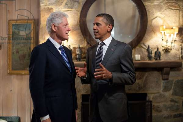 President Barack Obama talks with former President Bill Clinton. April 29, 2012. They were attending an election year campaign event at McLean, Virginia