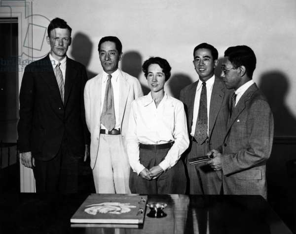 American pilot Charles Lindbergh, counselor at the Japanese Embassy S. Kato, Anne Lindbergh, Secretary of the Embassy H. Terasaki, and the Japanese Attache H. Tanaki, shown as Mr. and Mrs. Lindbergh receive their passports at the Japanese Embassy, Washington, D.C., July 28, 1931.