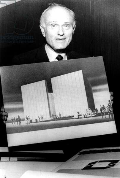 PHILIP JOHNSON holding his design for the John F. Kennedy Memorial in Dallas, Texas, 1965
