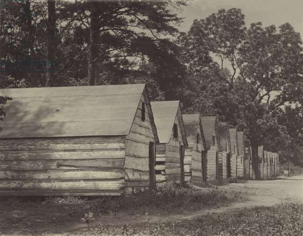 African American shacks, original caption: 'The negro berry pickers shacks on the farm of Col. J. J. Ross. The interior of these shacks consists of a flooring of straw, a few bags, and absence of light and air', Ross, Delaware, photograph by Lewis Wickes Hine, May, 1910