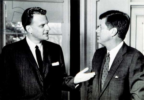 Billy Graham greets President John F. Kennedy in unannounced White House visit, 12/2/61
