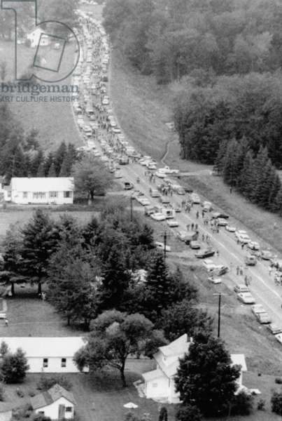 Leaving Woodstock Music Fair. Aerial view of cars crowded on a highway about 10 miles from the Woodstock Music and Art Fair as some 450,000 young people head home from the 3 day festival. Aug. 17, 1969