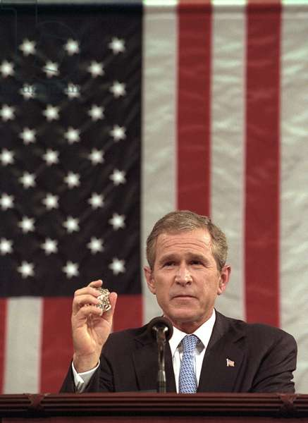 President George W. Bush holds the badge of a Port Authority Police officer killed on Sept. 11, 2001. Bush 43 said, 'I will carry this. It is the police shield of a man named George Howard who died at the World Trade Center trying to save others', during his speech to a joint session of Congress on Sept 20, 2001