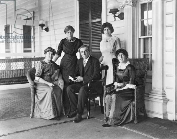 Woodrow Wilson with his first wife Ellen Louise Axson 1860-1914 and his three daughters L to R Jessie Eleanor and Margaret on the porch of Wilson's summer home in Sea Girt New Jersey in 1912. Ellen died of kidney disease in the second year of his presidency