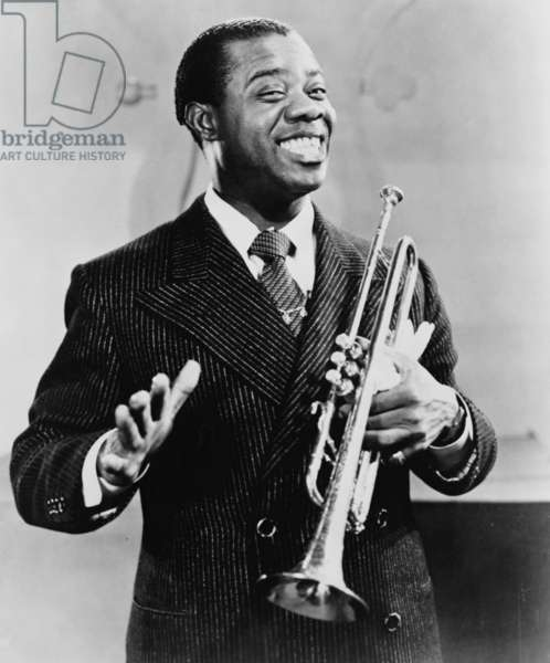 Louis Armstrong (1901-1971), African American Jazz musician, holding his trumpet, 1948