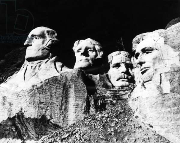 A nearly completed Mount Rushmore, with the faces of U.S. Presidents George Washington, Thomas Jefferson, Theodore Roosevelt, and Abraham Lincoln, Rapid City, South Dakota, November 12, 1941.