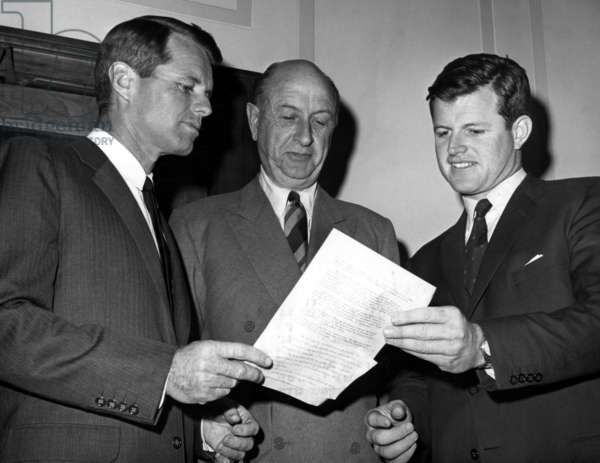 Attorney General Robert Kennedy (l) and Senator Edward 'Ted' Kennedy (r) present Eugene Black with position of Chairman of Trustees for the John F. Kennedy Library, Washington, D.C., January 13, 1964