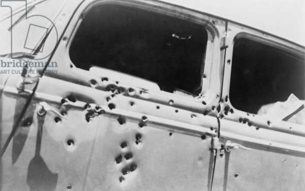 The bullet riddled car in which bank robbers Bonnie and Clyde died at the hands of Texas Rangers and Louisana police at Gibsland, Louisiana on May 23, 1934. Faye Dunaway and Warren Beatty stared in the 1967 film, BONNIE AND CLYDE